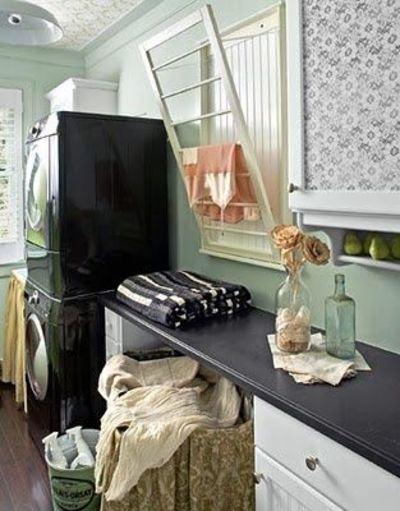 Wall-mounted drying rack in laundry room. {LOVE...WANT}