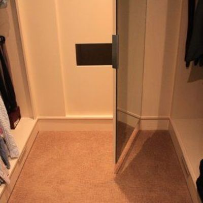 Laundry chutes in closets.