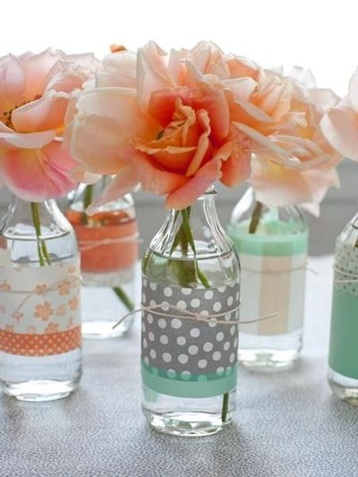 Pretty roses in bottle vases...looks like (or could use) washi tape for trim!