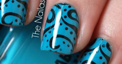 blue and black swirls and dots nail art. So cool! but it would take forever.