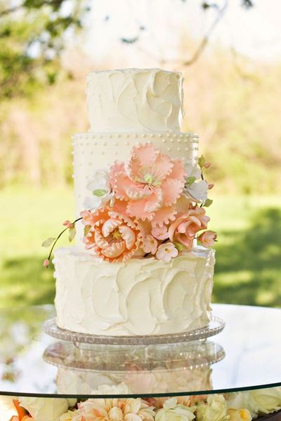 Peach and ivory wedding cake