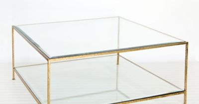 worlds awayQuadro Gold Leaf Square Coffee Table 18�€ h x 37�€ w x 37�€ d Square hammered umber gold leaf 2-tier coffee table with beveled glass tops. stock #: QUADRO G