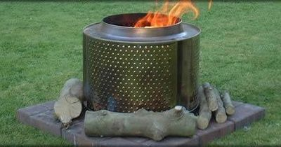Old washing machine drum used as fire pit