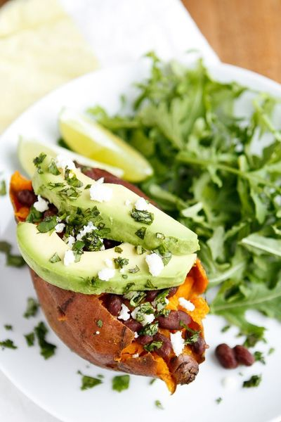 Baked Sweet Potato -- these loaded baked sweet potatoes, topped with honey-lime chipotle black beans, sliced avocado, crumbled queso fresco, and chopped fresh cilantro, are a fantastic meatless meal solution! One of our fave Lent recipes...   via