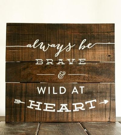 Words to live by painted by hand on reclaimed wood.