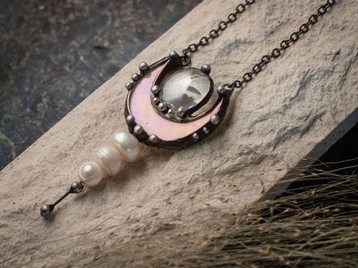 Pendant with 3 pearl, miniature mother of pearl crescent from light green to pink iridescence stain glass. $32.00