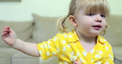 2 years old girl recording cutest birthday message for mommy