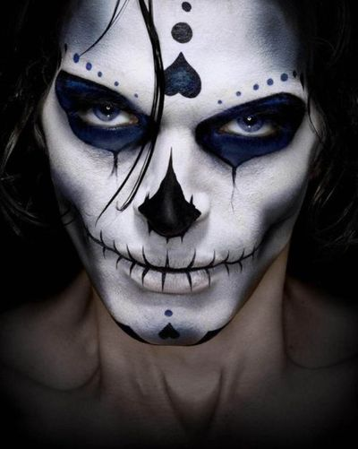 Skeleton makeup with some incorporated sugar skull makeup features.