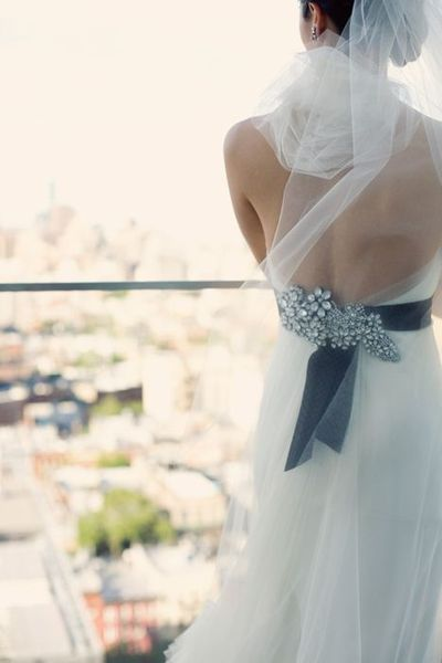 Beautiful broach for a wedding dress. It doesn't always need to be in the front. Your guests will be amazed at the beauty of the back of your dress as well.