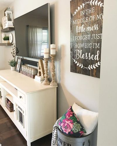 Split level living room, living room decor, farmhouse decor, farmhouse style, rustic decor, modern farmhouse, target decor, Hobby Lobby decor, living room Remodel, fixer upper, candlesticks, tv console decor, tv display, floating shelves, wooden sign, tv ...