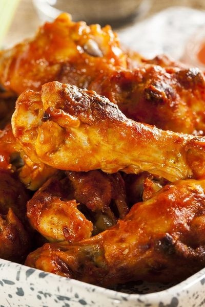 Unbelievable Baked Buffalo Wings Recipe. Made for Super Bowl 2014. Big hit. Used 1 tbsp cayenne and a lil less than 1 tsp crushed red pepper for 4 lbs wings. Used real butter instead of margarine.