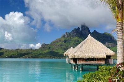 Unwind over crystal blue waters at The St. Regis Bora Bora Resort