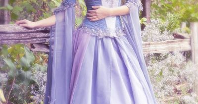 This is actually a wedding dress. I'd love a dress like this, only white and more modest (is that the right way to say it?). I love it though! :D