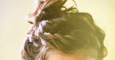 A braid and messy bun. Love!