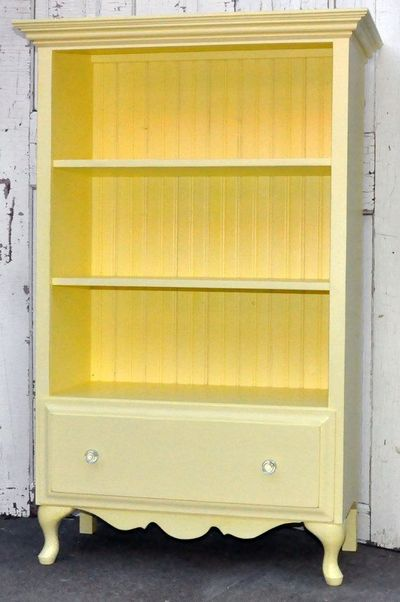 Turn a dresser into a book shelf. So cute. Shelves would actually be big enough to store scrapbooks!! Great for craft room.