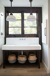 This California home by RailiCA design is a trendy take on modern farmhouse style. You've got some modern graphic tile, statement murals, rustic and industrial