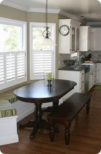 Bay window seating with nice half-window shutters for privacy