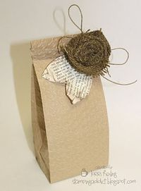 burlap flower with leaves cut from pages or leaves - dear embellishments to a gift bag!