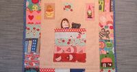 pattern in the book 'Pretty in Patchwork' doll quilts by Cathy Gaubert