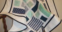Modern baby boy quilt in navy white and mint by ArtistryWithFabric, $135.00