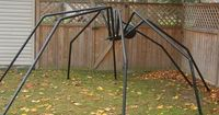 DIY Giant Spider by Sssgarry, halloweenforum: Made with PVC piping fastened to a board with U-bolts. #Halloween #DIY #Spider