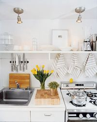 Use screw hooks in you wall to hang towels and save counter space
