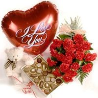 BOUQUET OF RED CARNATIONS, TEDDY BEAR, BOX OF CHOCOLATES AND A HEART SHAPED BALLOON