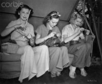 "Young Lucille Ball and Friends Knitting Together. Original caption: Patricia Wilder, Anne Shirley, and Lucille Ball, (left to right), are the three young ladies studiously applying themselves to their ""knit one purl one"" between scenes on ..."