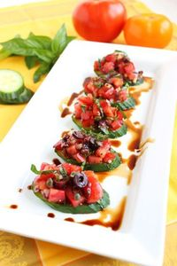 This refreshing summer snack replaces the bread in traditional bruschetta with crispy, crunchy cucumbers. Topped with a flavorful, tangy tomato, olive and caper