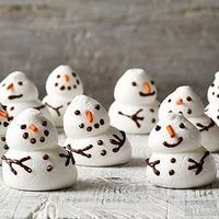 This Christmas dessert recipe can be customized into a variety of different holiday shapes. Make an army of meringue snowmen, Christmas trees, and Santa hats to
