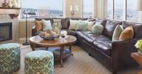 Decorate around brown furniture: The pillows tie the room together ~ they pick up wall color, lamp shades, accessories, art, ottomans, table, and window treatments; dark vanilla rug w/ dark binding and light graphic pattern adds another layer of pattern a...