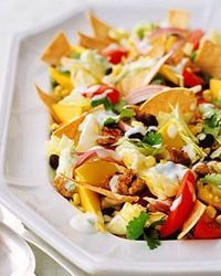 Taco Salad is a delicious and thoroughly satisfying meal. Ground turkey stands in for beef; nonfat yogurt laced with lime juice, jalapeno, and cilantro makes a creamy dressing. Fresh mango slices add a splash of color.