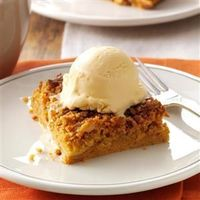"""Canned pumpkin with yellow cake mix make these bars an effortless alternative to pumpkin pie. It's a tried-and-true dessert that always brings big smiles. �€""""Lind"""