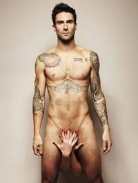 Adam Levine is a total HOTTIE! But he did this photo shoot with his girl as a Cancer fundraise......... Got my attention!