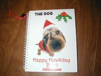 Happy Howliday Book by The Dogs as told by Howie Dewin (2006) for sale at Wenzel Thrifty Nickel ecrater store