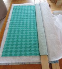 Color Me Quilty: Board Basting? Looks like a great way to baste on the dining table.
