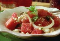 Watermelon Salad with Mint Leaves. I made this tonight with half the amount of olive oil and no feta. It was delish.