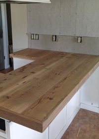 DIY Reclaimed Wood Countertop - building a wood counter top using reclaimed wood - how we did it -tips -and lessons learned.