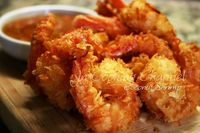 Coconut Shrimp - Crunchy, light and satisfying! Served with my own refreshing concoction of pineapple, mango, strawberry and honey Dijon with a hint of cilantro dipping sauce. What a great way to bring the tropics to your table! O-M-Goodness! www.facebook...