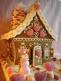 Valentine gingerbread houses - The scrollwork may be a bit much for kids, but looks cute.
