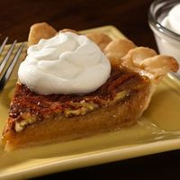 Pecan pie that is sure to become a tradition on your dessert table.