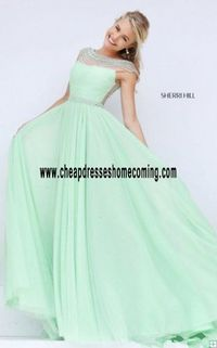Sheer boat neckline and cap sleeves unmask your toned shoulders Light Green Prom Dres