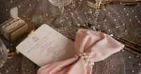 Elegant Wedding Tablescape �™� Pink Bow Tie Napkins, Lace and Pearl Tablecloth, and Pearl Napkin Rings Wedding Centerpiece