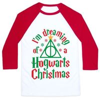 """This cute Harry Potter christmas shirt features a deathly hallows symbol with a star on top like a christmas tree and the phrase """"I'm dreaming of a Hogwarts christmas"""" and is perfect for people who love christmas, Harry Potter books or movie..."""