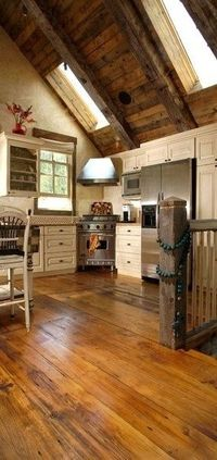 I love the look of old barn wood in a house but this takes it to a new level! Awesome kitchen~