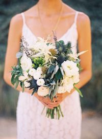 No matter the types of flowers, we love full, overflowing overgrown wedding bouquets of blooms and greenery.