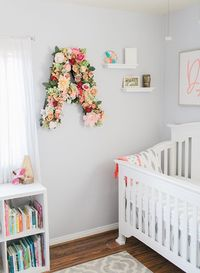 We love a girly nursery, and this one is just that and more! Whether you want to decorate with floral letters, or boho accessories, this nursery will offer you