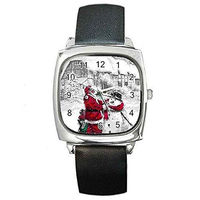 Christmas Santa Making Snowman on a Womens Silver Square Watch with Leather Band $32.00