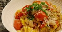 Roasted spaghetti squash and cherry tomatoes with basil