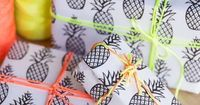 Fun pineapple gift wrap with neon thread.